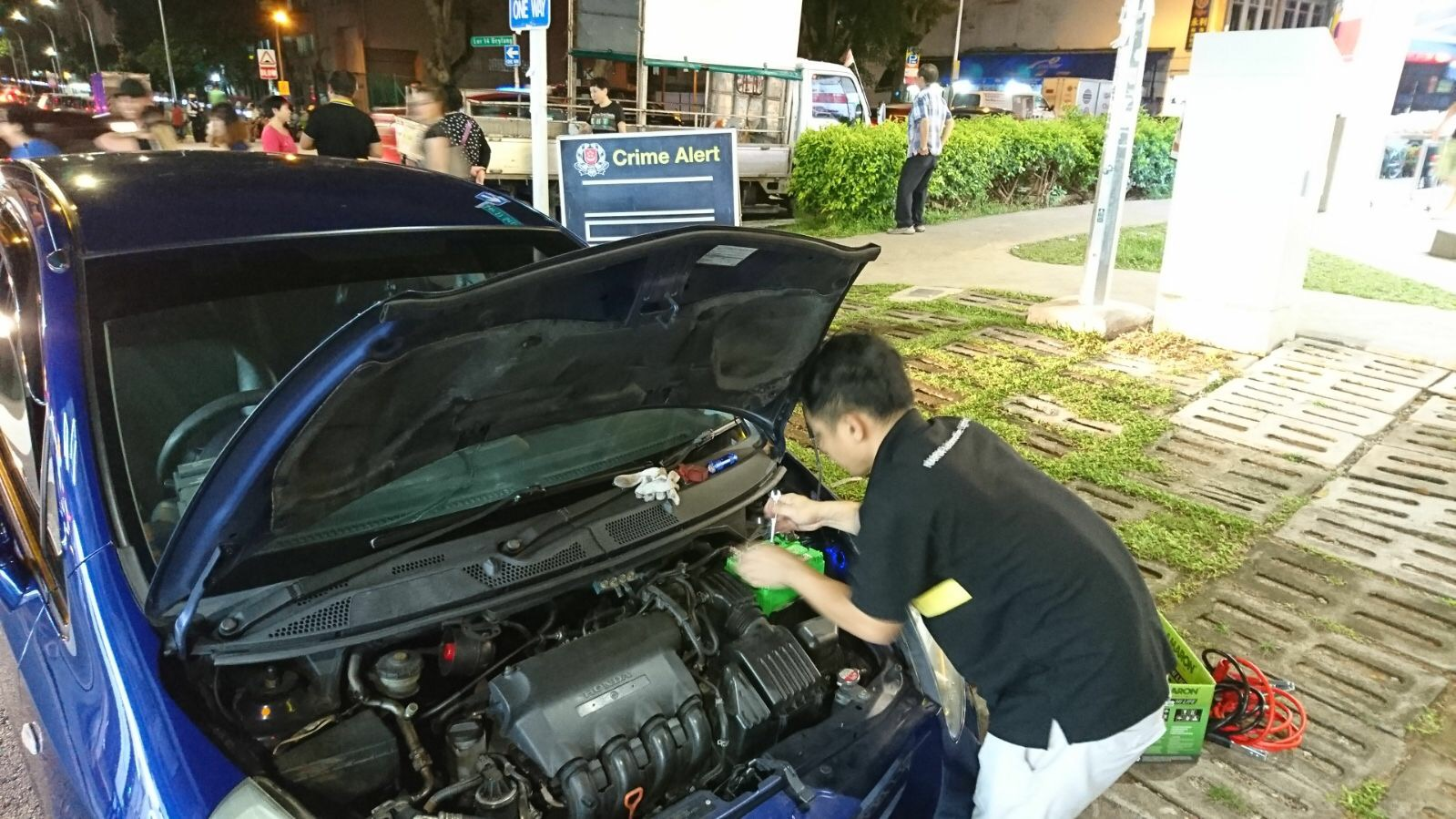 Changing Honda Fit battery at Geylang